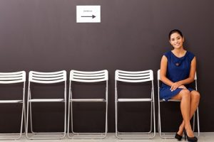 bigstock-beautiful-businesswoman-waitin-44018146-lowrez